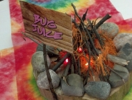 centerpiece Mitzvah camp fire tie dye log cabin